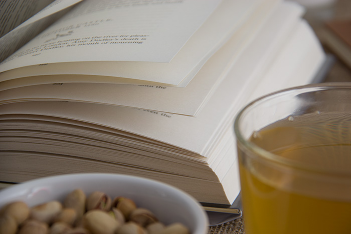 An open book, pistachio, tea - Lost in a Book Tag